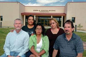 Hundreds Oppose Program, Teacher Cuts At Northern New Mexico College: From left, Northern New Mexico College staff members James Biggs, Patricia Perea, Annette Rodriguez, Crestina Quintana and Gilbert Sena, shown Thursday at the Española school's Joseph M. Montoya Adminstration Building, say their contracts were not renewed for the 2014-15 school year, and they suspect the decisions were due to retaliation over their complaints about. Clyde Mueller/The New Mexican
