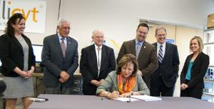 Martinez signs 'responsible' $6.235B budget