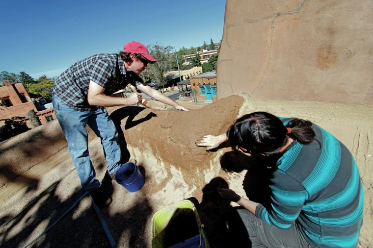 Furloughed workers volunteer to put mud plaster on San Miguel Mission