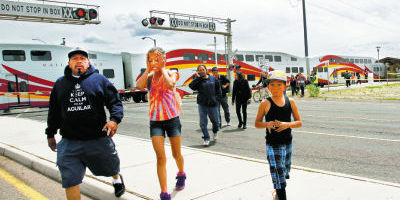 <p>Passengers on a southbound Rail Runner train to Albuquerque are escorted to city shuttle buses Saturday following a fatal collision with a bicycle rider at the Zia Road and St. Francis Drive. Jane Phillips/The New Mexican</p>