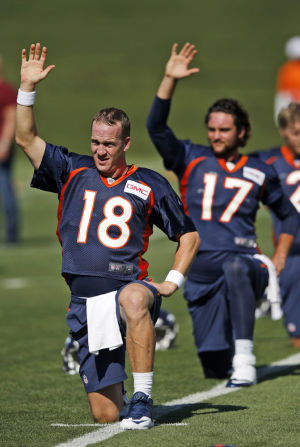 Manning getting used to new faces on Broncos