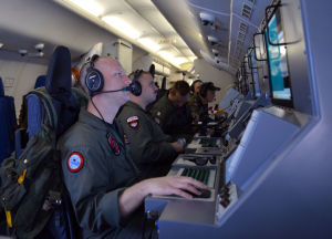 Crew members aboard a P-8A Poseidon surveillance aircraft during a sweep of the Indian Ocean looking for Malaysia Airlines Flight MH370