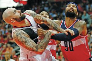 With Wall out, Hawks beat Wizards 106-90 to even series 1-1