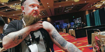 <p>'Gentle Jay' Blondel, a New York City tattoo artist, shows off some of his designs at the Santa Fe Tattoo Expo on Friday at the Buffalo Thunder Resort & Casino. The expo runs through Sunday. Jane Phillips/The New Mexican</p>