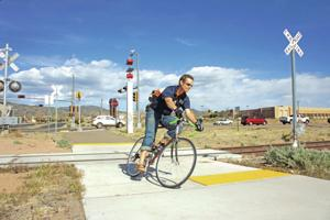 Cycling experts debate need for barriers where trails cross Rail Runner tracks