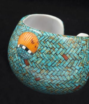 <p>Contemporary cuff by Angie Reano Owen (Santo Domingo Pueblo) features Red Mountain turquoise inlaid over a backing made from a single large shell</p>