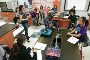 Ortiz Middle School students test bulbs, participate in 'trash fashion' project to learn about conservation