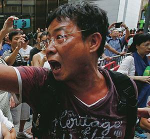 Hong Kong police arrest 19 at protest site
