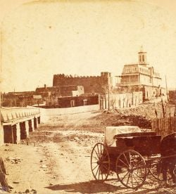 <p>San Miguel Chapel and St. Michael's College in the Barrio de Analco, looking south along what is today Old Santa Fe Trail, circa 1880, photo by Chas. A. Pollen</p>