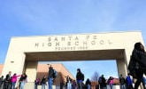<p>Santa Fe High School students are dismissed at the end of the school day last year. The school dropped from a B grade last year to a D this year. Clyde Mueller/New Mexican file photo</p>