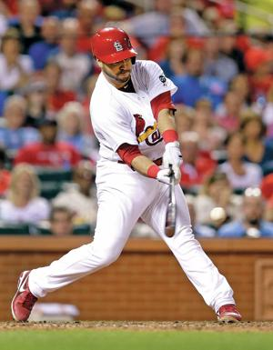 Cardinals rally from 5 down to beat Cubs