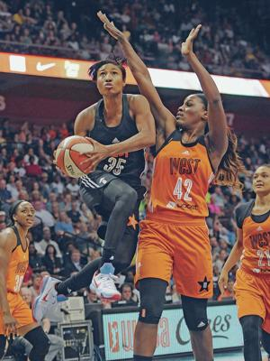 WNBA's Moore leads West to 117-112 win over the East
