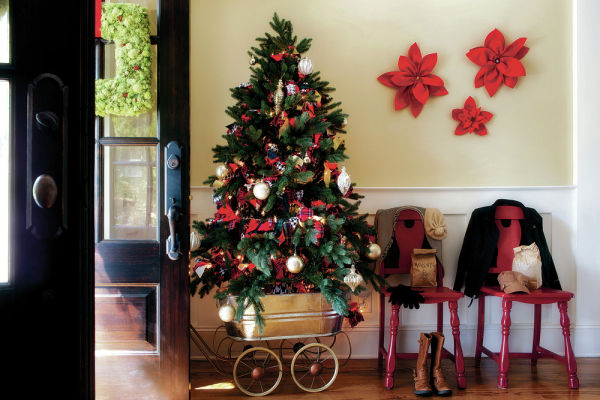 <p>Flynn uses a vintage metal wagon as a tree stand, so that this piece of holiday decor can easily be moved to any room where guests are congregating. AP/Brian Patrick Flynn, HGTV.com Holiday House</p>