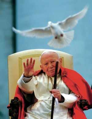 Vatican panel clears John Paul II for sainthood