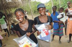 <p>Young women from Tanzania holdingSafe Motherhood Kits that provide sterile birthing supplies to some of the poorest populations of the world — one of the causes supported by the Santa Fe Alternative Gift Market</p>