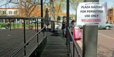 <p>A sign posted at the ramp of the Plaza Community Stage on Thursday alerts Plaza-goers that the bandstand is 'for permitted use only.' Luis Sánchez Saturno/The New Mexican</p>