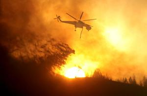 Clouds, added crews aid fight against Idaho fire