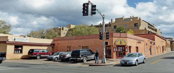 <p>Owners of San Francisco Plaza, a historic compound on the northeast corner of West San Francisco and Guadalupe streets, are seeking to tear down three of four buildings and add two new two-story buildings on the site. Clyde Mueller/New Mexican file photo</p>