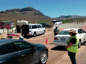 Protesters decry fee on road leading to Skywalk