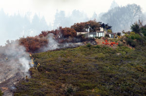 Unusual late fall fire still burning in Big Sur
