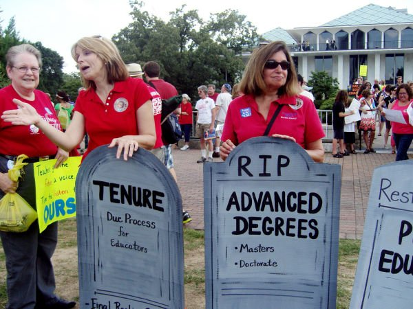 <p>People gather outside the North Carolina General Assembly in Raleigh, NC during summer 2013 to protest the elimination of tenure and extra pay for teachers with advanced degrees in the state. Efforts to eliminate extra pay for teachers who earn advanced degrees are gaining momentum in a small but growing number of U.S. schools. Among issues related to teacher pay that legislators are debating this summer include reinstating the extra pay for those teaching in the subject in which they got their advanced degree. (AP Photo/NCPolicyWatch.com)</p>