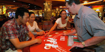 <p>Teresina Wickham trains employees at Pojoaque Pueblo's Buffalo Thunder Resort & Casino how to be black jack dealers in July 2008, as the casino prepared for its opening later that summer. The pueblo has submitted a proposal to the federal government that would allow it to serve alcohol on the casino floor, lower the gambling age and cease payments to the state of New Mexico. Jane Phillips/New Mexican file photo</p>