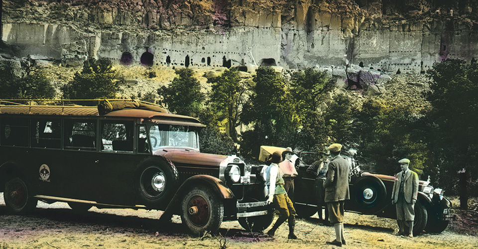 Detail of a lantern slide by Edward Kemp of an Indian Detours bus at Puye cliff dwellings, circa 1926-1930; courtesy Palace of the Governors Photo Archives (NMHM/DCA) LS.0586