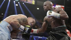 Mayweather wins a tough fight