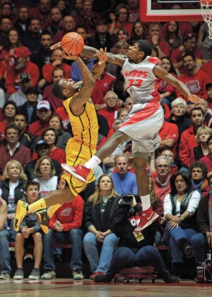 Lobos hold of Wyoming 66-61 in OT