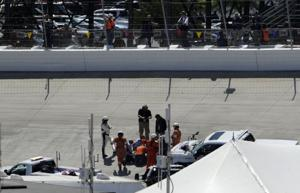 NASCAR race at Dover stopped because of potholes