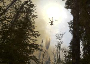 Alaska wildfire keeps growing after evacuations