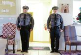 <p>From left, Deputies Marvyn Jaramillo and Gene Meek stand guard Thursday in the lobby of Rivera Family Funeral Home. Deputies will remain on watch with Jeremy Martin's body until his funeral services, set for 11 a.m. Saturday at Capital High School. Luis Sánchez Saturno/The New Mexican</p>