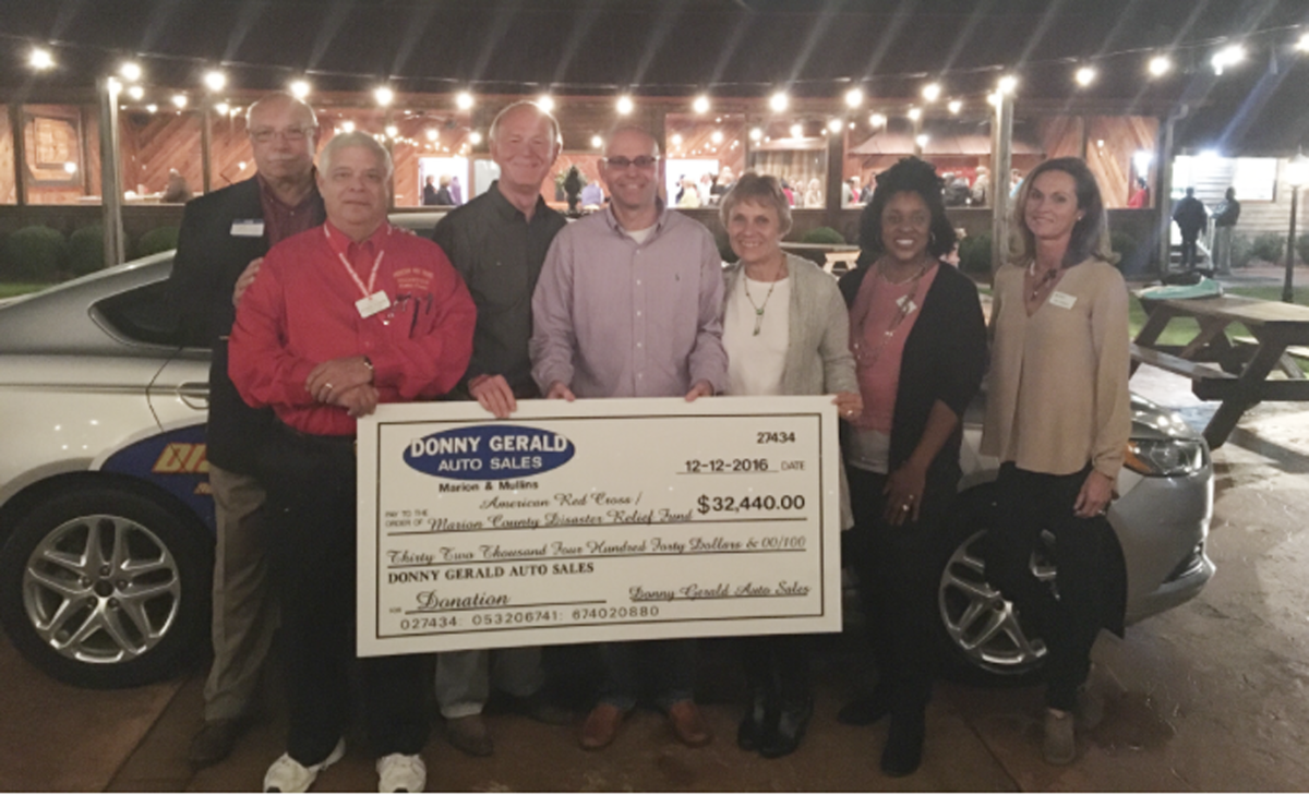 Car dealer helps raise money for Marion County disaster