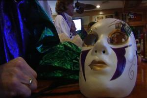 Lou Layton shows off his Mardi Gras mask at Dead Dog Saloon.
