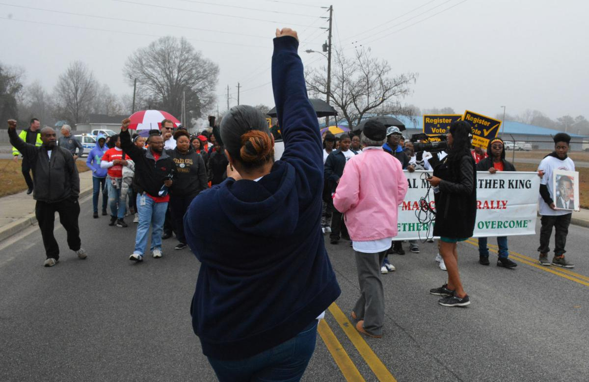 About 500 people – black, white and Hispanic -- marched into ...