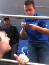 <p>AJ Allmendinger signs an autograph for Chris at Homestead-Miami Speedway during his Petty Enterprises days.</p>