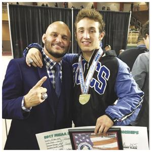 Father and Son - South Dade Wrestling Head Coach Victor Balmeceda and Sophmore Brevin Balmeceda with his 2nd State Championship