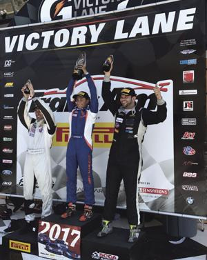 Ernie Francis Jr. (middle) celebrates his first win in the TA class at Homestead-Miami