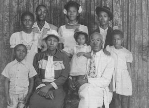 <p>The Barrett family in their early years. Pictured, from left, are (back row) Ruth, Harding, Agnes, and James Hannah; (front row) James Hamilton, Getrude Hunter Barrett, baby Gertrude Alexander, Simeon E. Barrett, and Irene.</p>