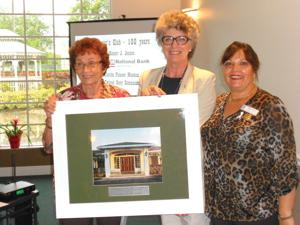 <p>Lorene Strano, (left) is presented with a framed photo of the Woman's Club by Yvonne Knowles (middle) and Yvette Douherty, president of the Soroptimist Club.</p>