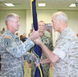 <p>Marine General F. Kelly, the commander of US Southern Command, hands the US Special Operations Command South (SOCSOUTH) unit colors to Army Brig. Gen. Kurt L. Sonntag, officially making him the commander of SOCSOUTH during an assumption of command ceremony on September 16 at the command's headquarters in Homestead.</p>
