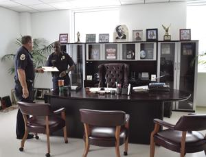 Homestead Chief of Police Al Rolle hard at work in his office, along with Homestead Police Colonel Scott Kennedy
