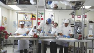 Chef Myrna Betancourt instructing her students.  From left: Maria Del Carmen Perez, Ana Hinez, Lazaro Mendilvo, Chef Betancourt and Arturo Saucedo.
