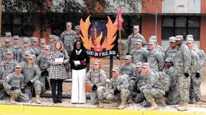 <p>Hannah Parker, center, left, director of Vivian B. Adams School, Ozark and Danelle Peterman, principal of D.A.Smith Middle School, Ozark received donations from the WOCS Class 15-07 of the U. S. Army Warrant Officer Career College at Fort Rucker. </p>