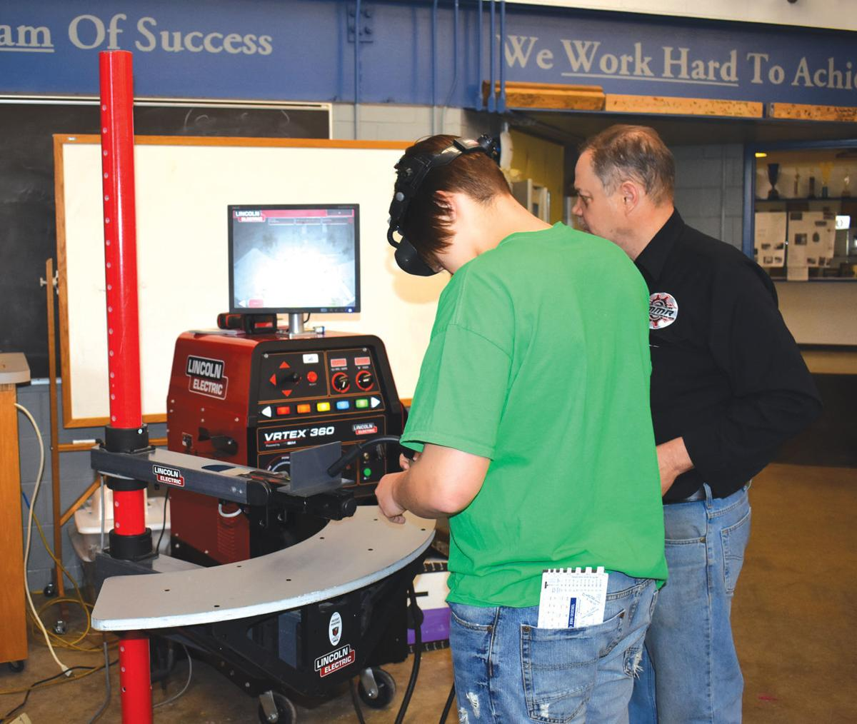 Owatonna students get closer look at welding and other industrial tech Friday from Riverland instructors