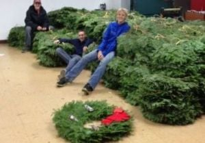Waseca Boy Scouts unload wreaths for their annual fundraiser