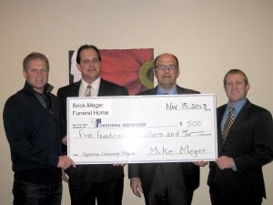 Brick-Meger Funeral Home donates to Owatonna Foundation
