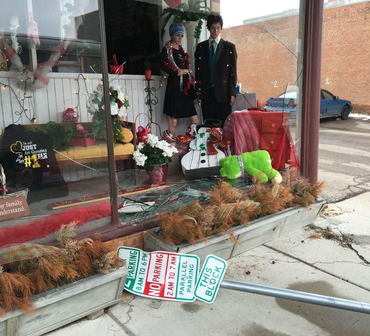 Crash causes chain reaction, street sign shatters store window
