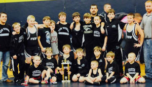 Wrestlers with trophy