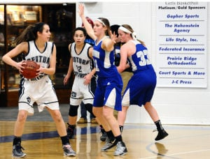 <p>The Owatonna girls basketball team, led by seniors Kyndal Cox, center, and Katlin Ptacek, right, ride a 12-game winning streak into tonight's Section 1AAAA semifinal with Rochester John Marshall. The Rockets have also won their last 12. (Kaleb Roedel/People's Press)</p>